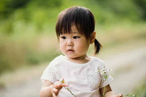 Baby Girl Walking In Outdoors Stock Photo - Download Image Now