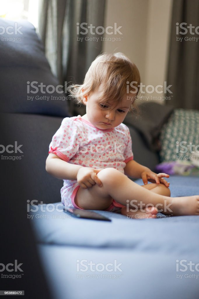 baby girl watching a mobile phone - Royalty-free 12-17 Months Stock Photo