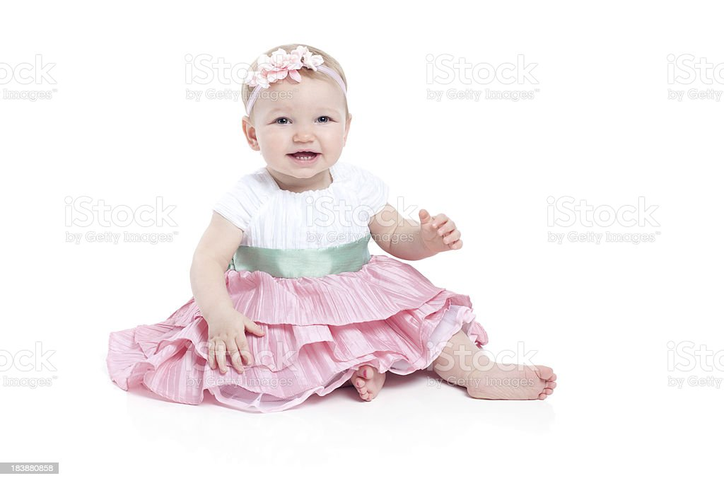 Baby Girl Wearing Dress and Sitting on White Background royalty-free stock photo