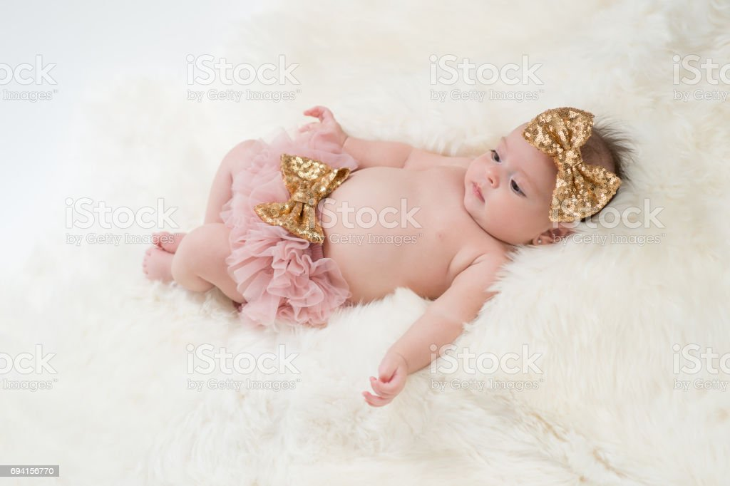 Baby Girl Wearing Pink Bloomers stock photo