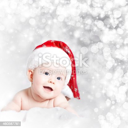 istock Baby girl wearing red Santa hat 460587761