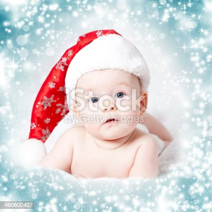 istock Baby girl wearing red Santa hat 460600427