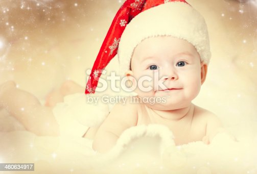 istock Baby girl wearing red Santa hat 460634917