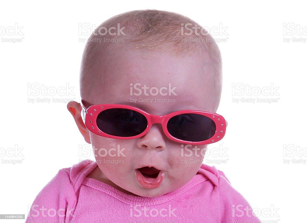 Baby girl wearing sunglasses stock photo