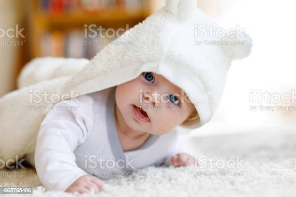 Baby girl wearing white towel or winter overal in white sunny bedroom picture id665765486?b=1&k=6&m=665765486&s=612x612&h=i0clagf7p08eihvtb3 padxoyvwunau p28jkelwbti=
