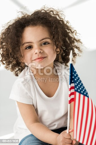 istock baby girl with american flag 684837808