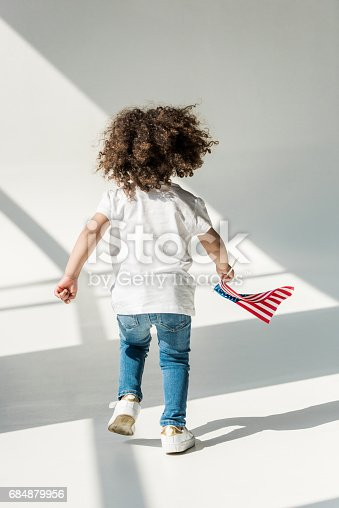 istock baby girl with american flag 684879956