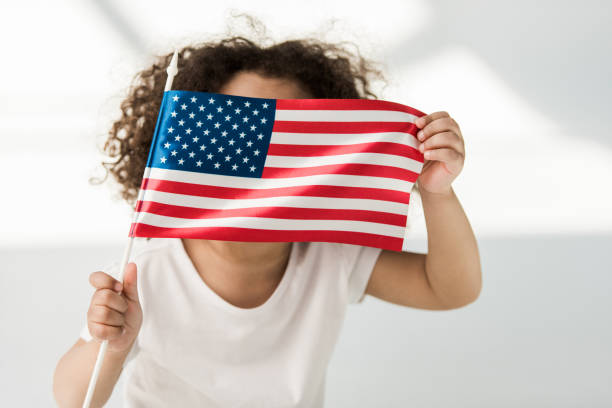 baby girl with american flag stock photo