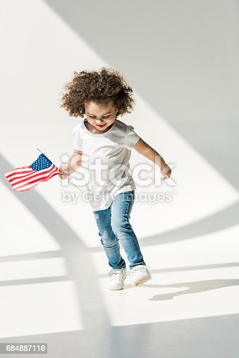istock baby girl with american flag 684887116