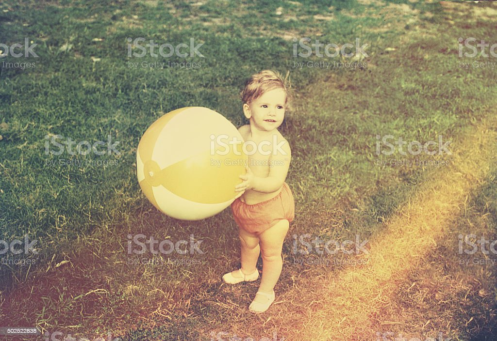 Baby Girl with Beach Ball stock photo