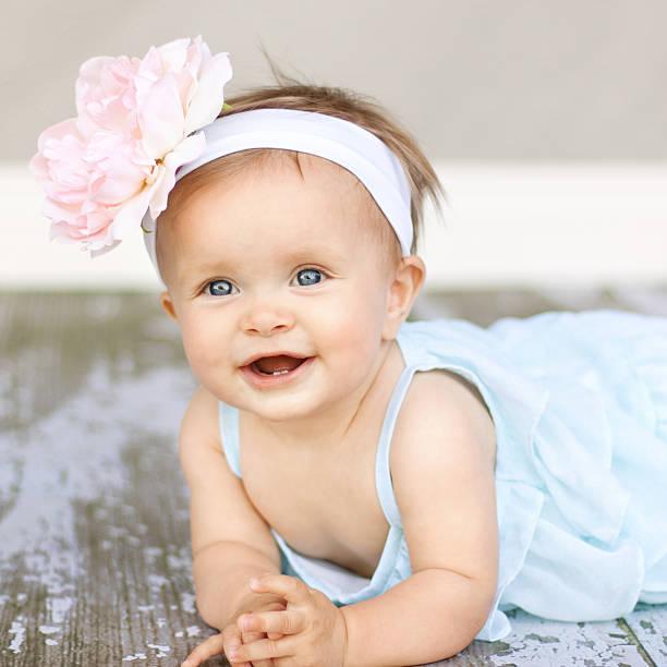 Baby Girl with big flower headband stock photo