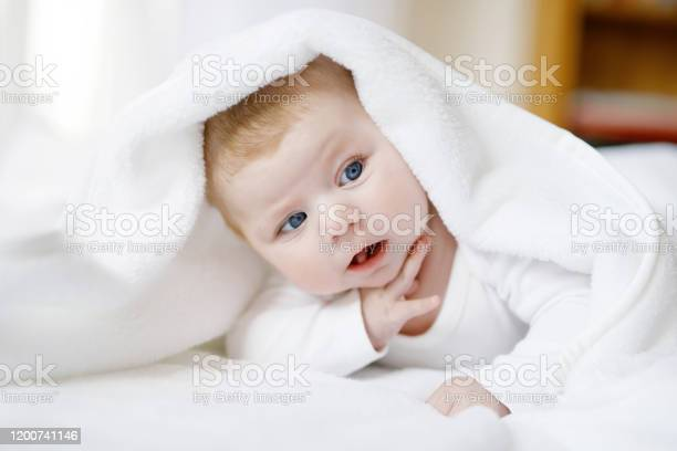 Baby girl with blue eyes wearing white towel or blanket in white picture id1200741146?b=1&k=6&m=1200741146&s=612x612&h=bdmcbptpokzdfytpzlqyjk fjbu1eoxd7akurdzdebq=