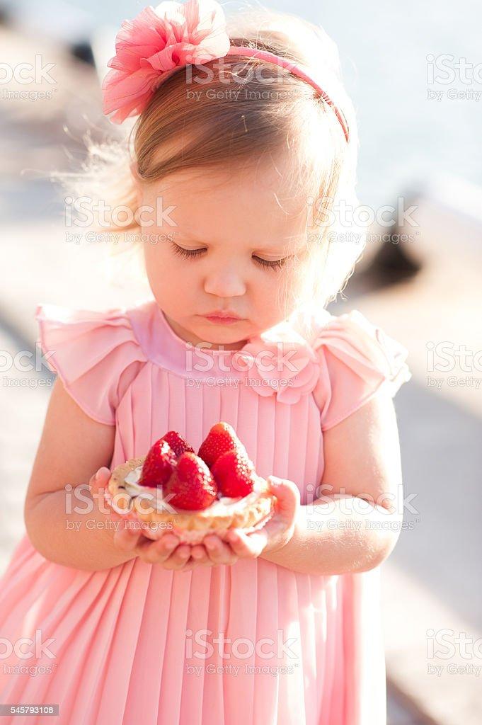 Baby girl with cake stock photo