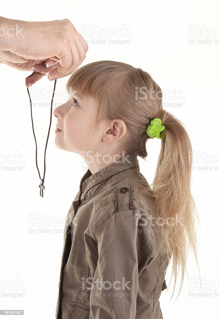 baby girl with Christian cross royalty-free stock photo