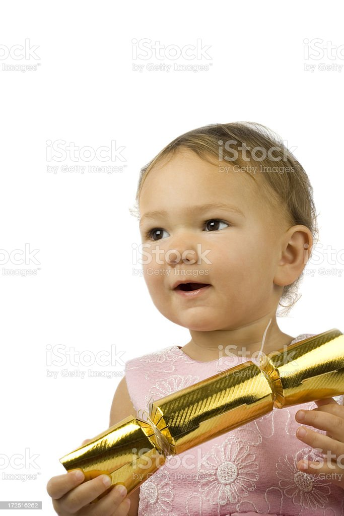 Baby girl with cracker royalty-free stock photo