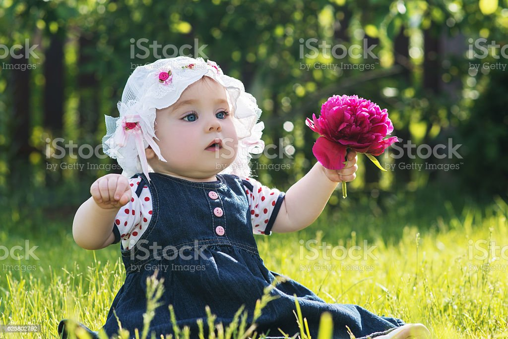 a48bc8ac40 Baby Girl With Flower On The Nature Outdoor Stock Photo   More ...