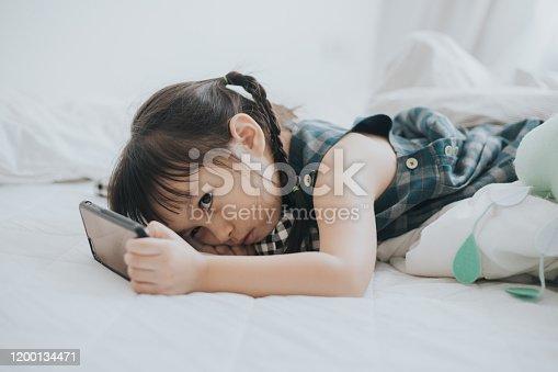 boring baby girls while using phone indoors, Bangkok, Thailand, horizontal, technology, nomophobia