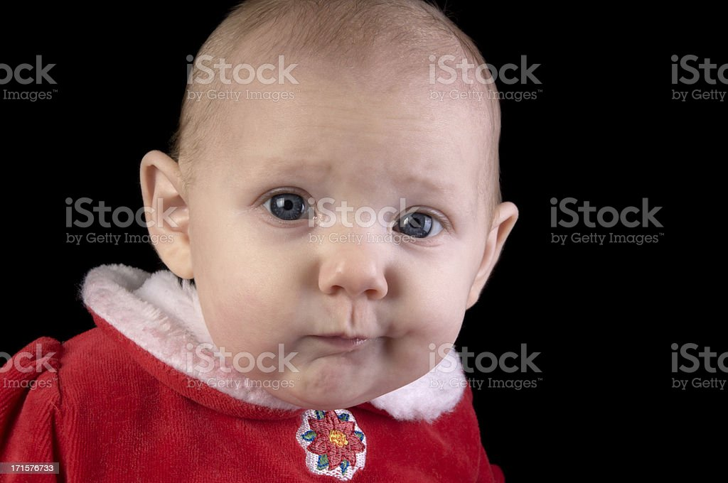 Baby girl with interesting expression. stock photo