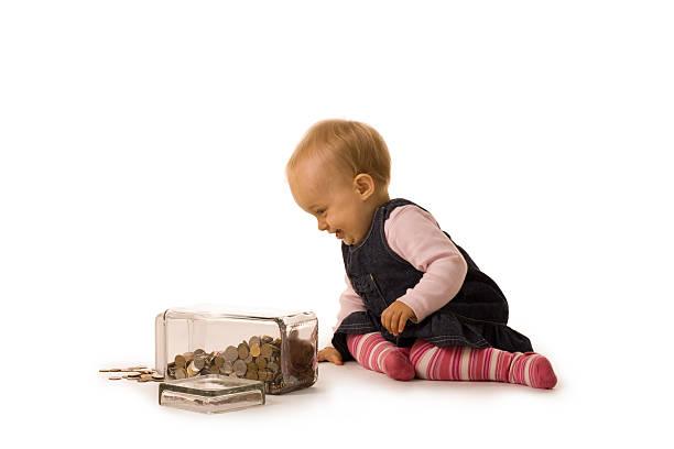 Bébé fille avec de l'argent - Photo