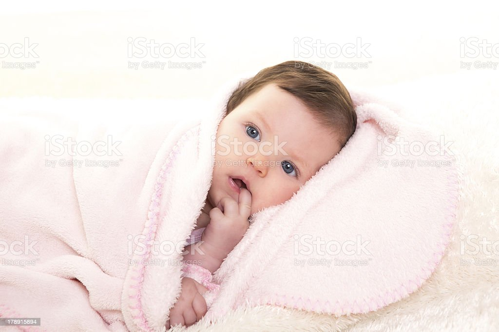 baby girl with toothache in pink  white fur royalty-free stock photo