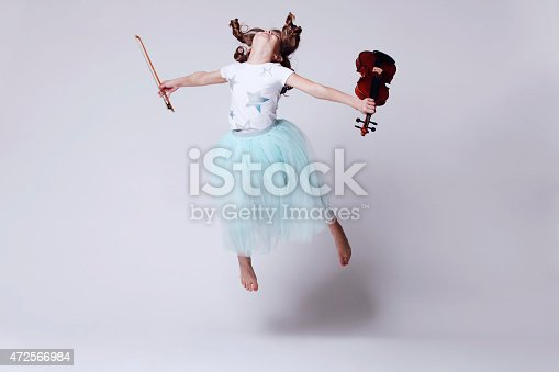 istock Baby girl with violin 472566984