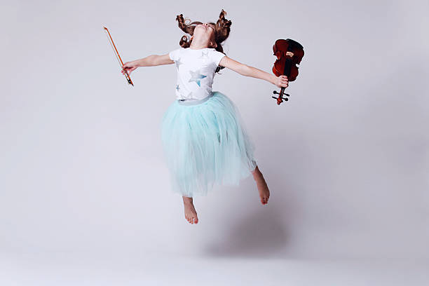 baby girl with violin - classical stock photos and pictures