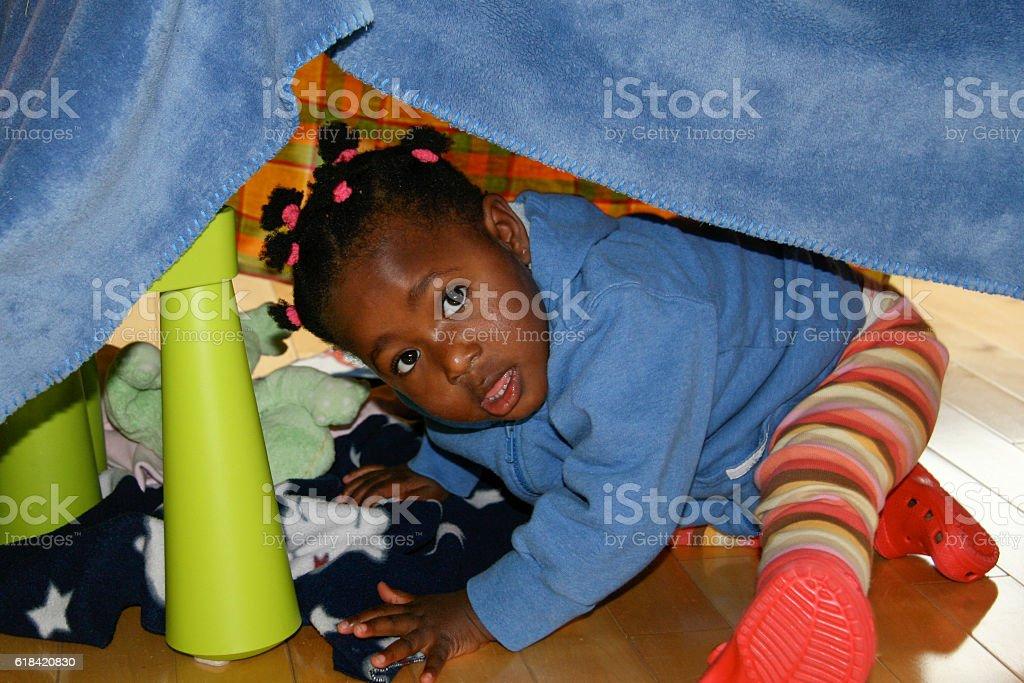 Baby Girls Hiding in Homemade Tent stock photo