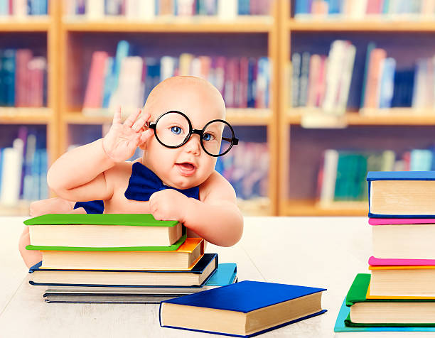 baby glasses read books, kid development education, library book shelves - genius stock photos and pictures