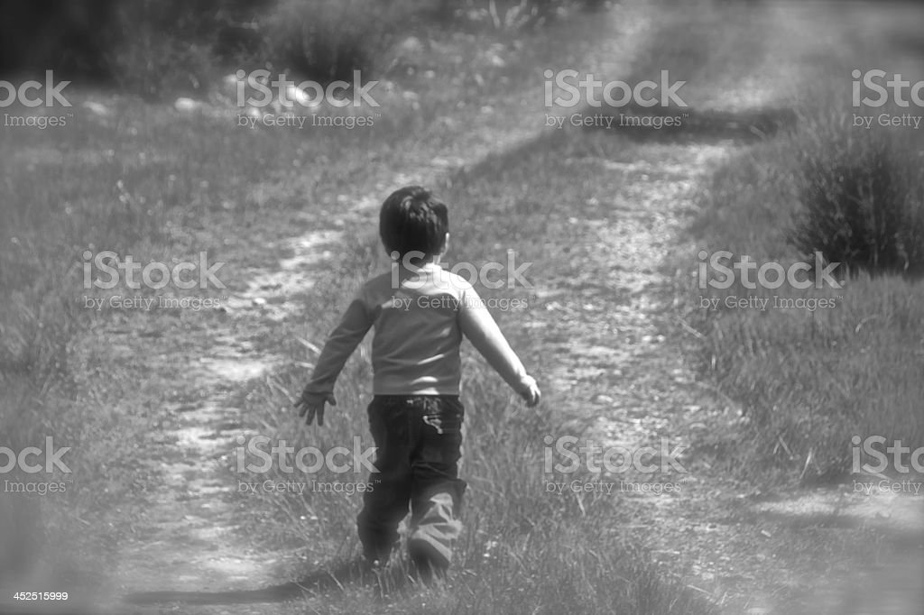 A baby going on the road less traveled  stock photo