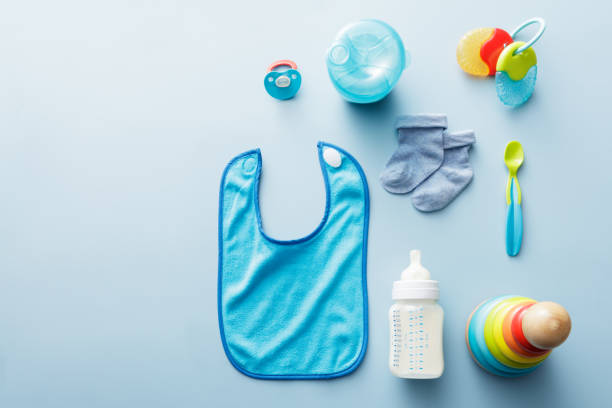 baby goods: baby goods for boys collection - group of objects stock pictures, royalty-free photos & images