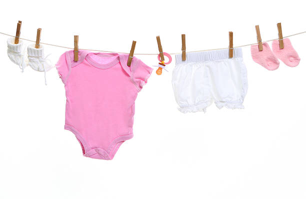 Baby goods hanging on the clothesline stock photo