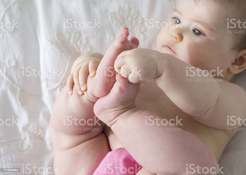 Baby grabs her toes royalty-free stock photo