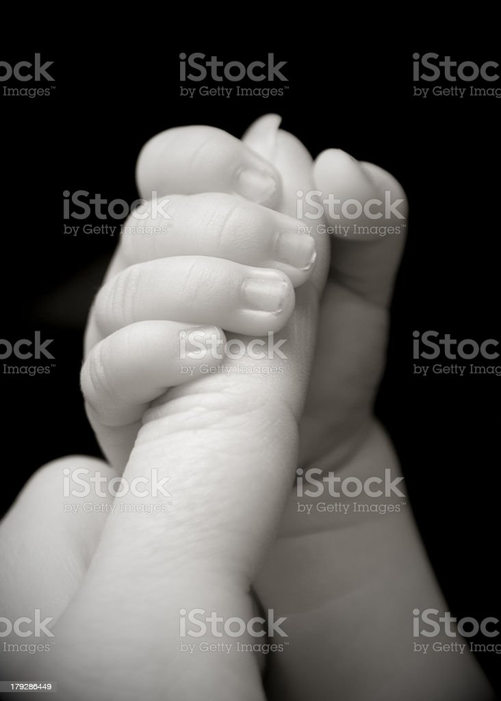 Baby Grasping Mother's Finger stock photo