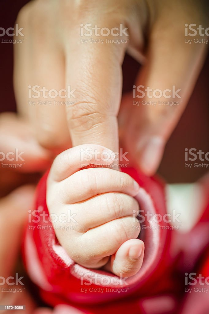 Baby Gripping Parents Finger royalty-free stock photo