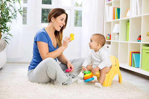 Baby growing up and leaving diapers stock photo