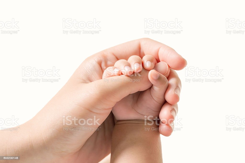 Baby hand holding finger mom on isolated background. (Selected focus) – Foto