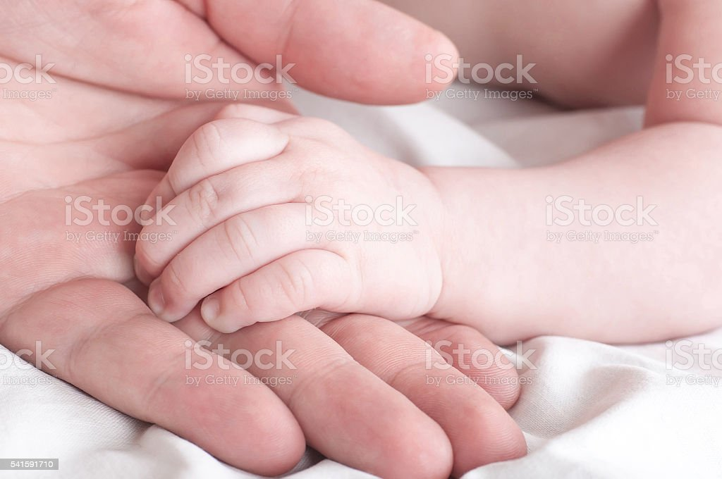 Baby handles on the mother's stock photo
