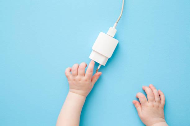 Baby hands exploring white charging phone cable with plug on light picture id1219133750?b=1&k=6&m=1219133750&s=612x612&w=0&h=dq 9oxbpsql rivd1vaxad9pkolamlxjooff9wcgv54=