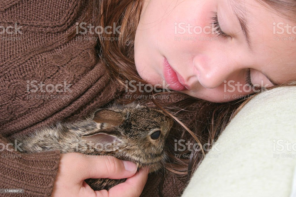Baby hare with girl royalty-free stock photo
