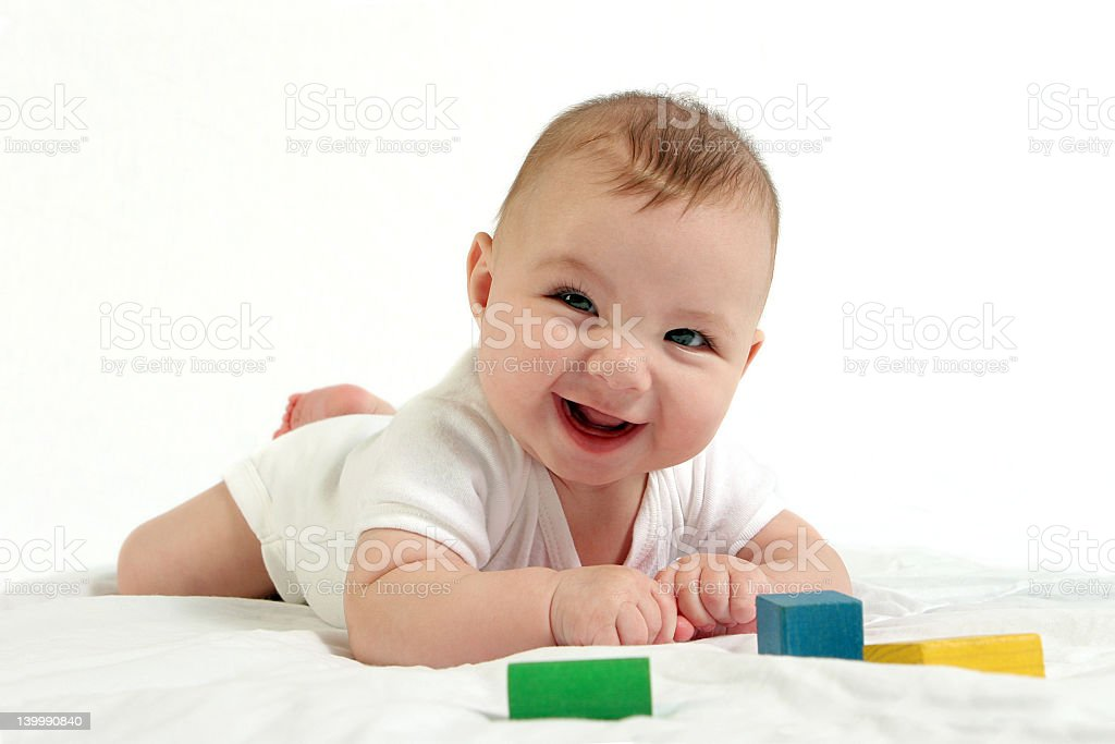 Baby have tummy time and playing with blocks  stock photo