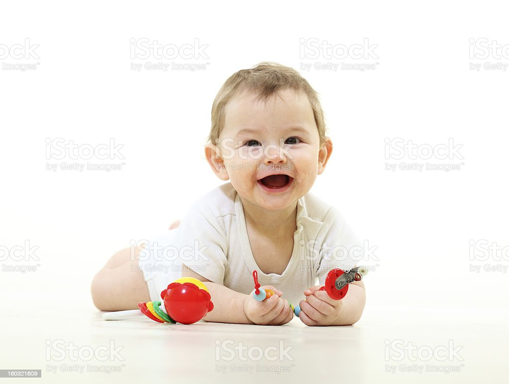 Baby having fun with simple toys royalty-free stock photo