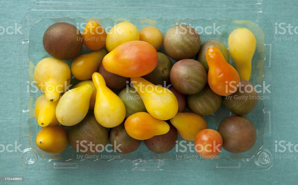 Baby heirloom tomatoes in a container royalty-free stock photo
