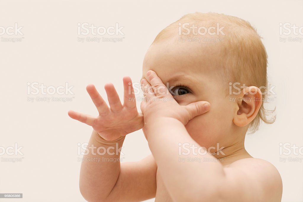 baby hiding with hands XL stock photo