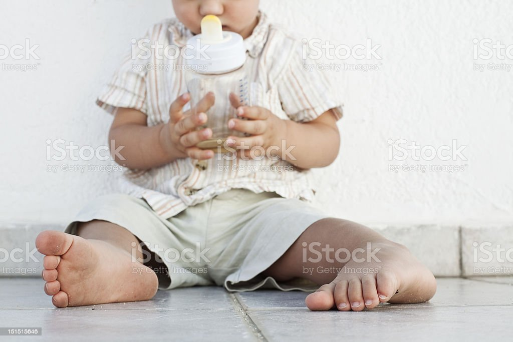 Baby Holding A Bottle Stock Photo - Download Image Now ...