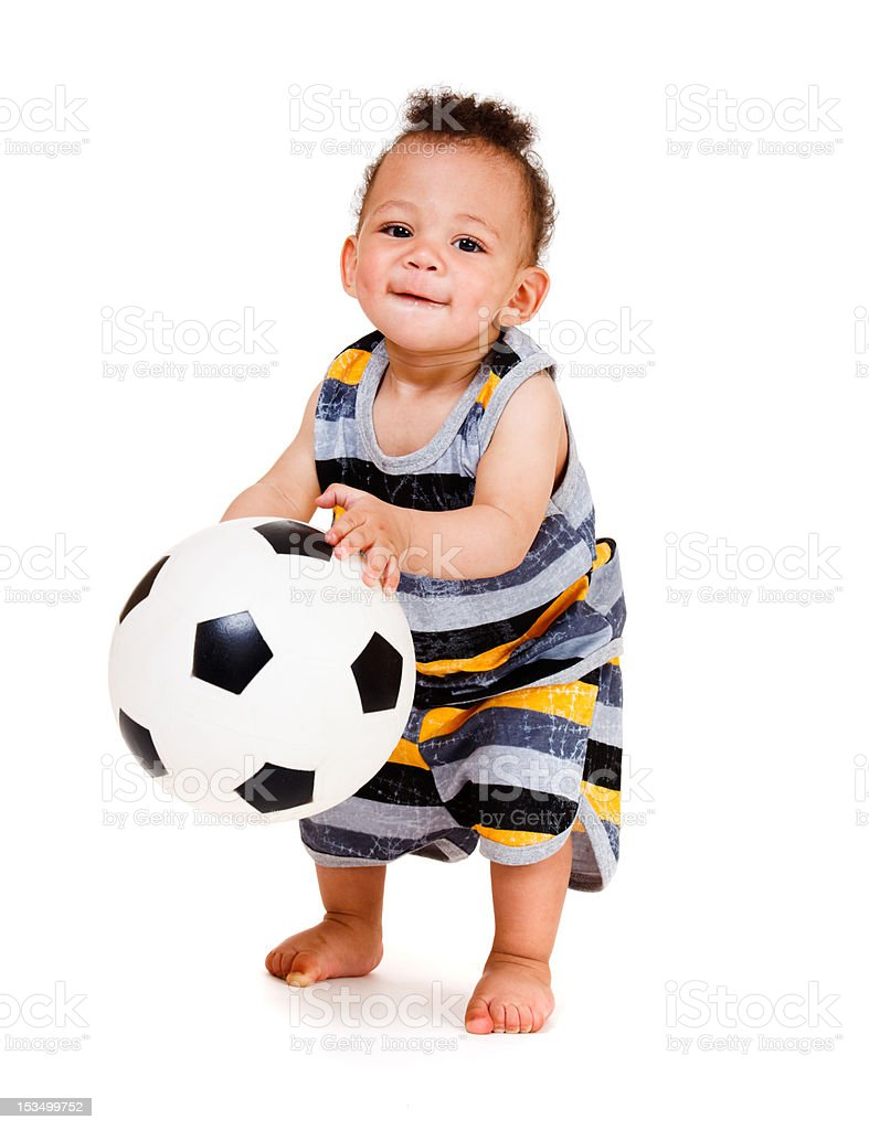 Baby holding  ball stock photo