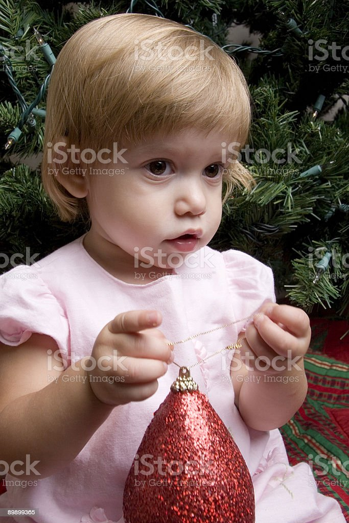 Baby Holding Christmas Ornament royalty-free stock photo