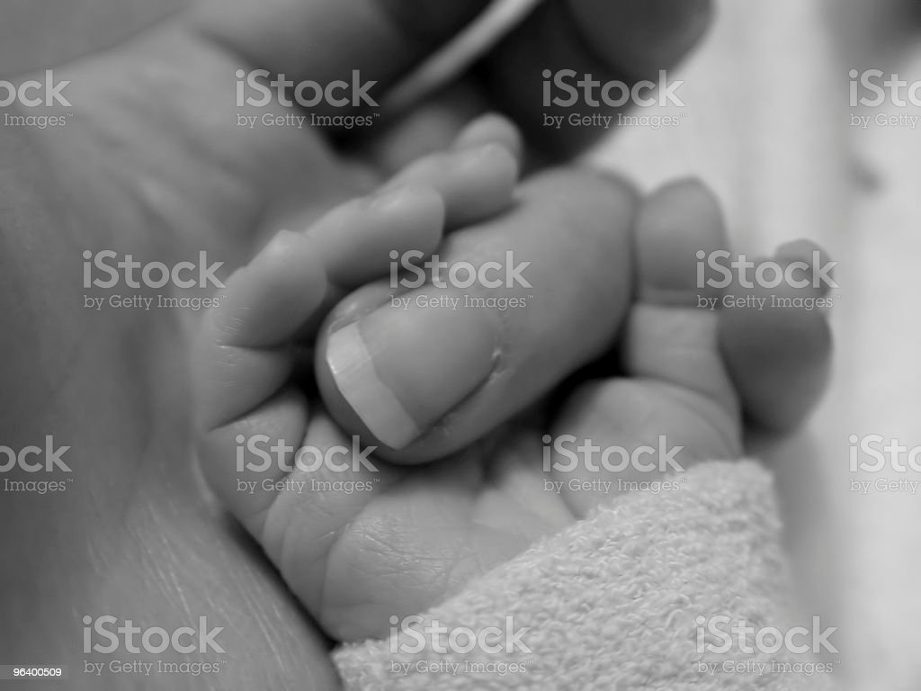Baby Holding Mothers Finger royalty-free stock photo