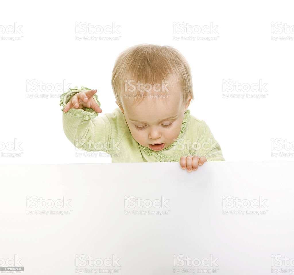Baby holding sign or board isolated on white stock photo