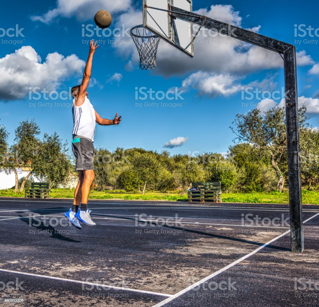 Baby hook shot in a basketball playground stock photo