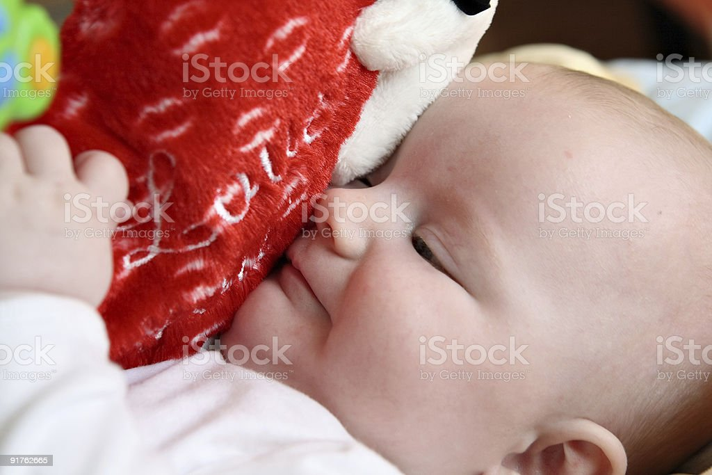 Baby hugging big plush heart royalty-free stock photo